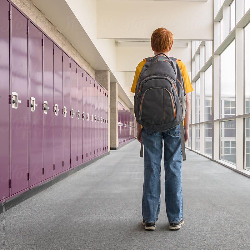 Boy Standing in School Hall by Julie Rideout for Stocksy United