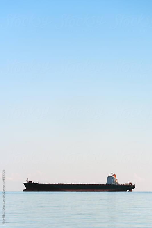 Oil tanker ship in the morning light by Luca Pierro for Stocksy United