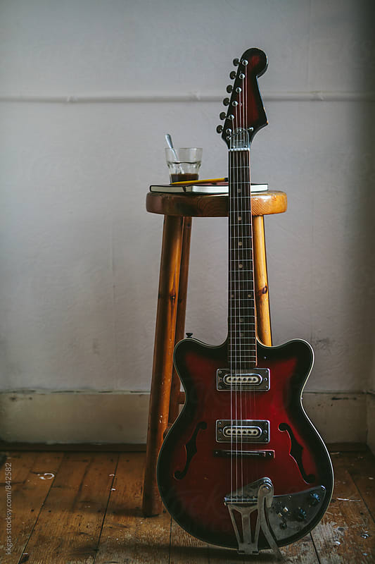 Guitar and glass of coffee on a stool by kkgas for Stocksy United