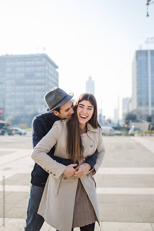 Happy young couple having fun together by michela ravasio for Stocksy United