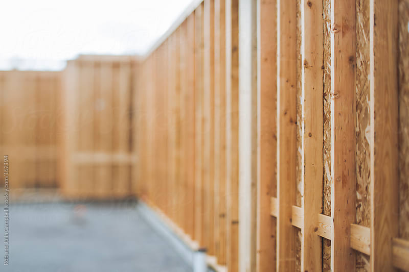 Detail of framed wall at construction site by Rob and Julia Campbell for Stocksy United