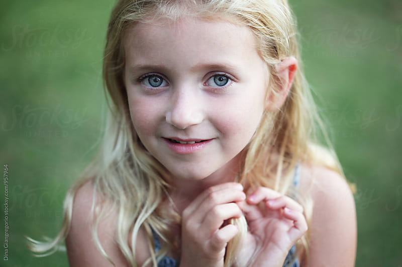 Outdoor Portrait Of Young Blonde Girl by Dina Giangregorio for Stocksy United