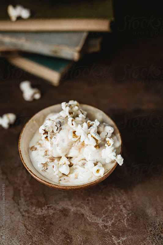 Caramel ice cream with popcorn by Tatjana Ristanic for Stocksy United