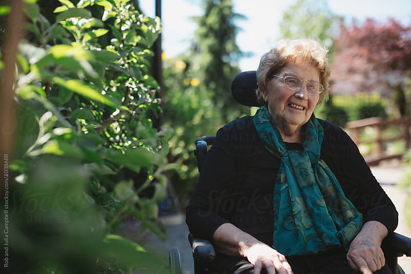 Smiling, caucasian senior woman outside in wheelchair by Rob and Julia Campbell for Stocksy United