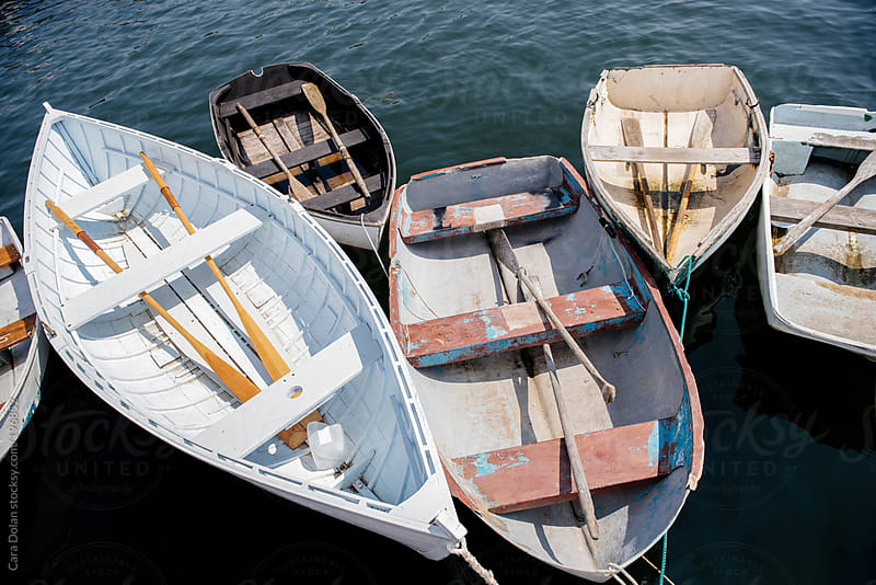 Rowboats tied to a dock by Cara Dolan for Stocksy United