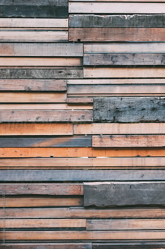 Various types of recycled wood paneling on wall of building exterior by Paul Edmondson for Stocksy United