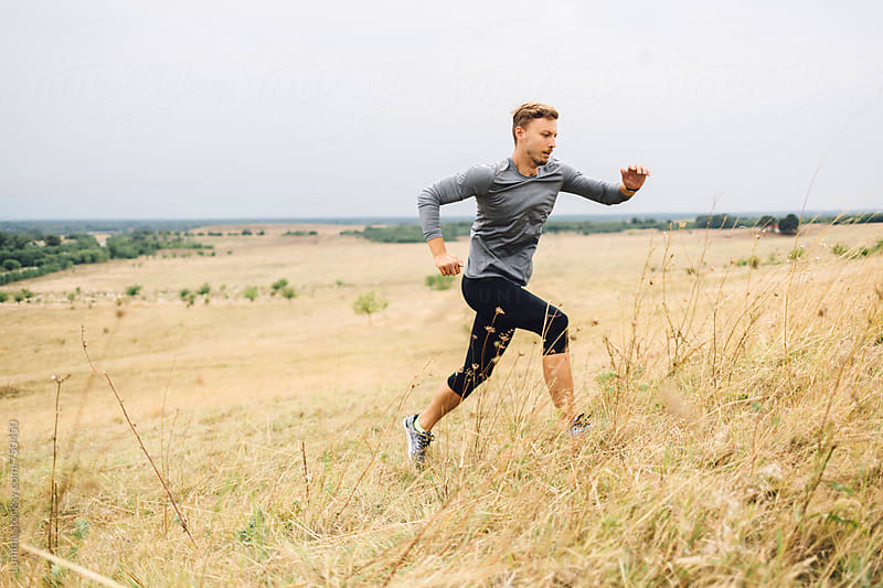 Fit Man in Sportswear Jogging Outdoors by Lumina for Stocksy United