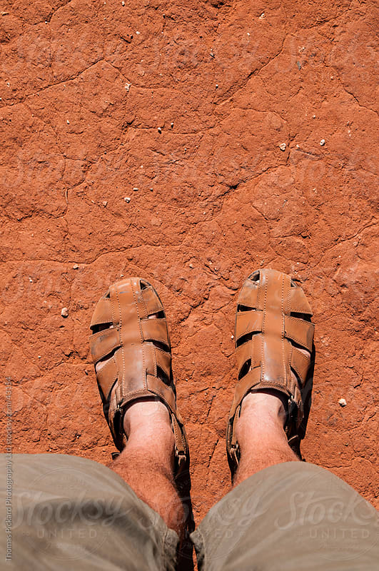 Man's shoes covered in red dirt, outback Australia. by Thomas Pickard for Stocksy United