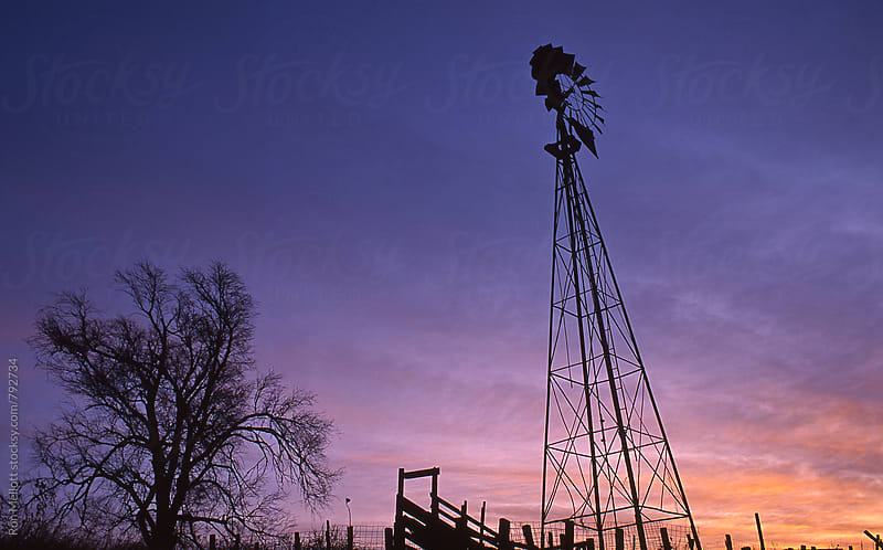 prairie windmill at sunset by Ron Mellott for Stocksy United