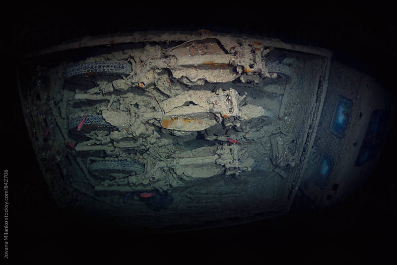 Inside of Thistlegorm shipwreck, the old truck caring three motorbikes   by Jovana Milanko for Stocksy United
