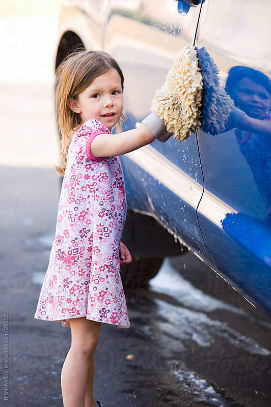 Childhood: Little Girl Washing Pickup Truck by Brian McEntire for Stocksy United