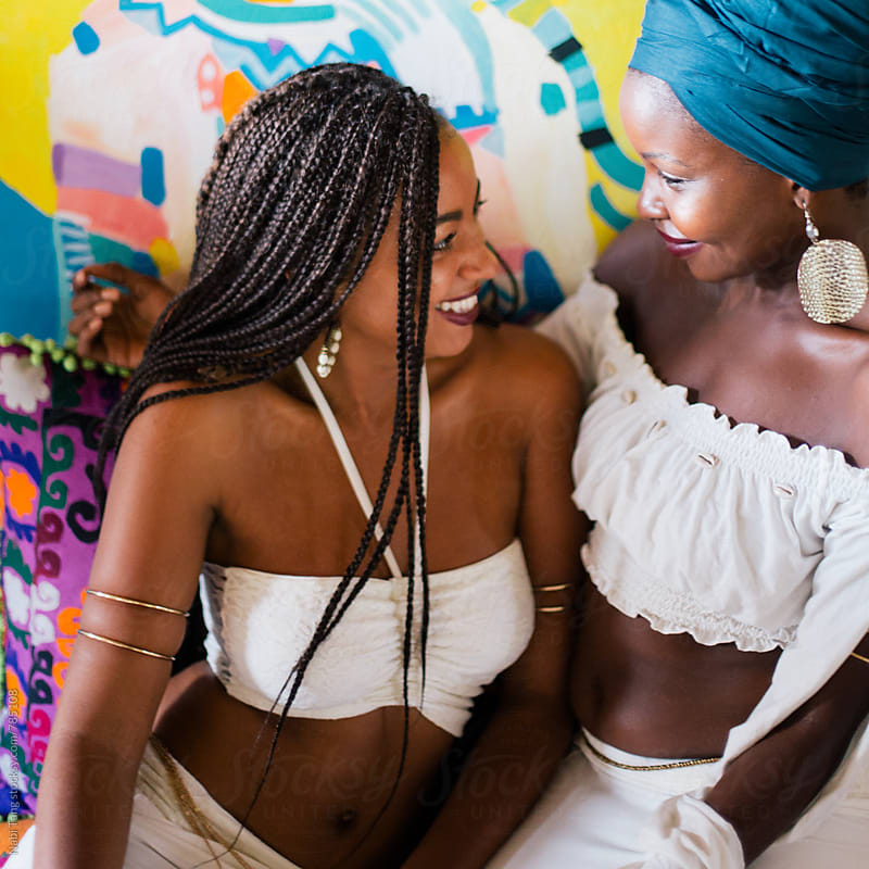 Beautiful young african women enjoying time together by Nabi Tang for Stocksy United