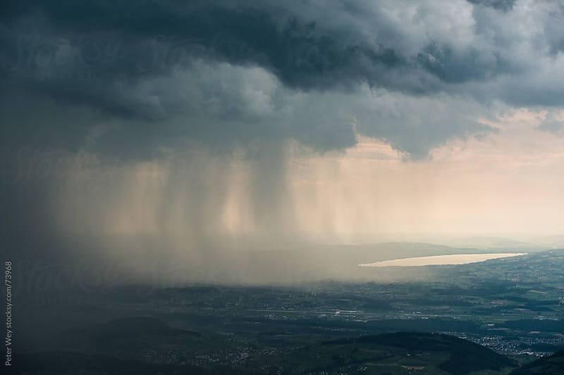 Heavy rain during summer storm. by Peter Wey for Stocksy United