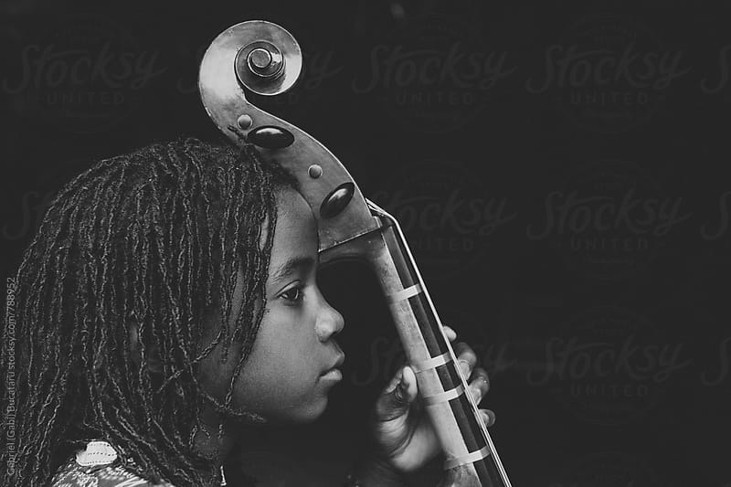 African American girl with cello in black and white by Gabriel (Gabi) Bucataru for Stocksy United