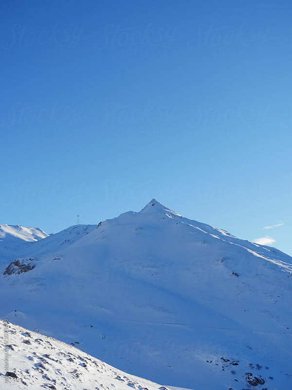 Mountain peak against of blue sky by rolfo for Stocksy United