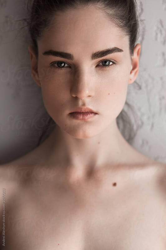 Portrait of a young sexy girl closeup by Andrei Aleshyn for Stocksy United