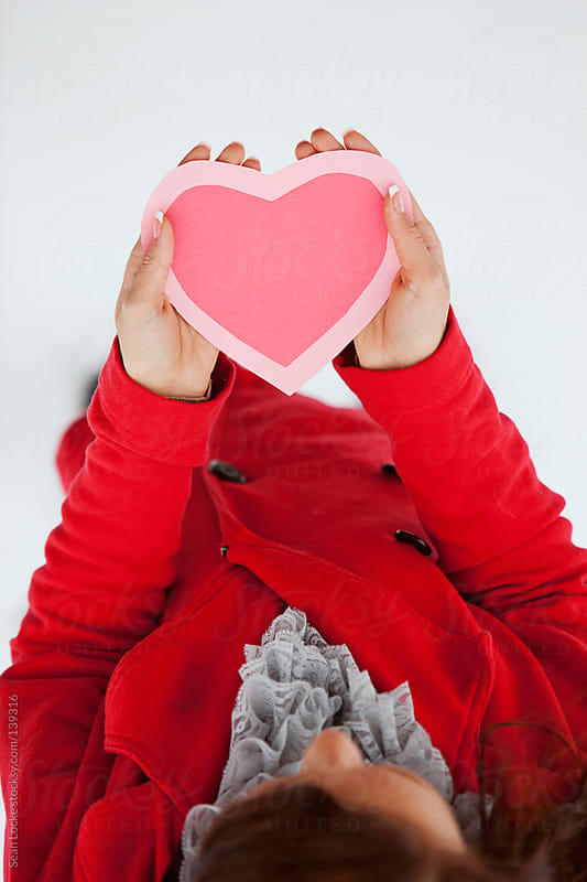 Valentine's: Woman In Red Holding Paper Heart by Sean Locke for Stocksy United