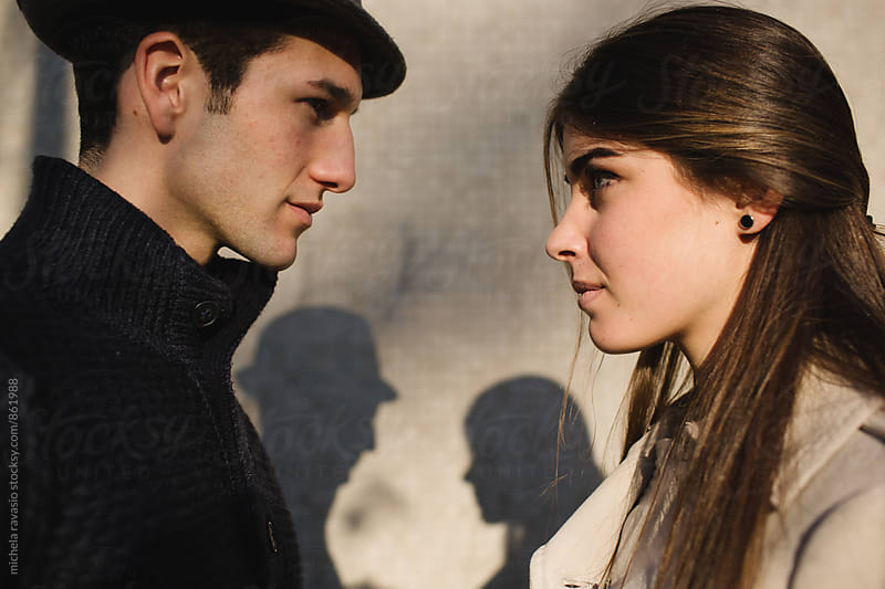 Young man and young woman looking in opposite directions by michela ravasio for Stocksy United