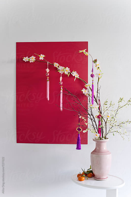 Chinese New Year flower arrangement by Alita Ong for Stocksy United
