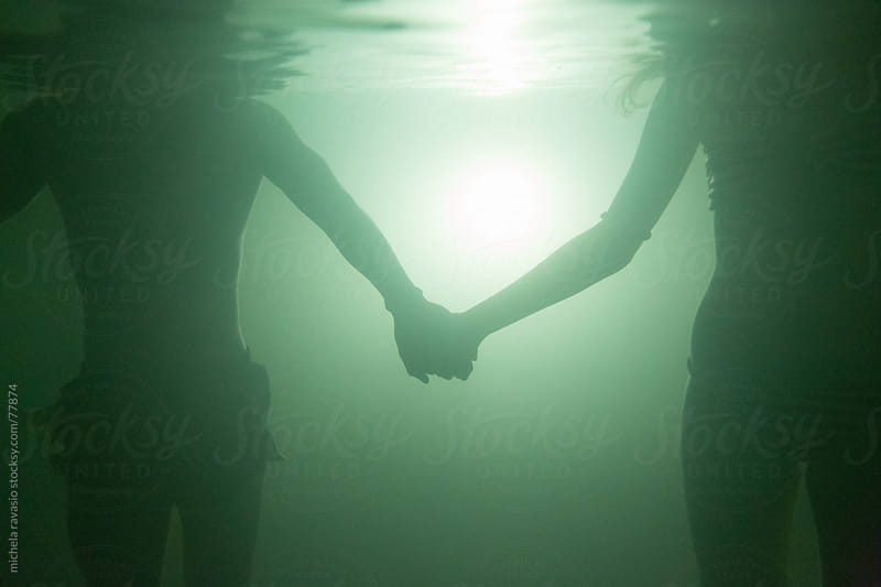 Couple underwater by michela ravasio for Stocksy United