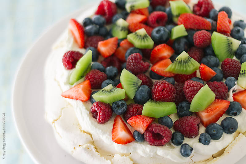 Pavlova horizontal with summer fruits by Kirsty Begg for Stocksy United