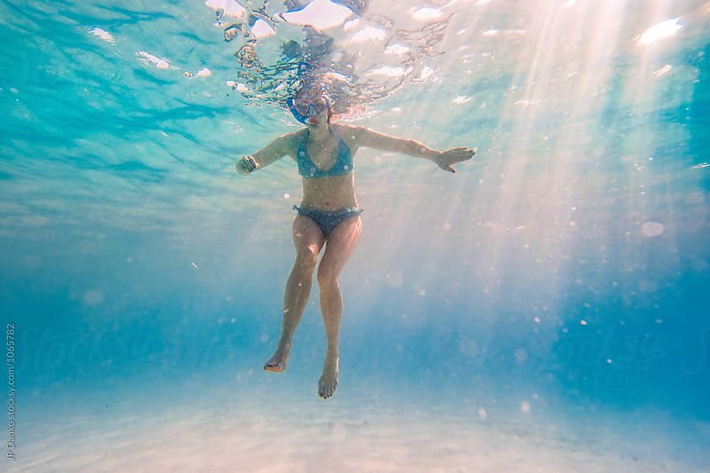 Woman Swimming Floating Underwater at All Inclusive Caribbean Resort White Sand Beach by JP Danko for Stocksy United