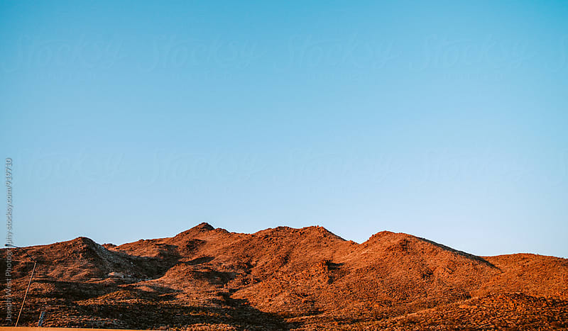Desert landscape in sun and shadow by Joseph West Photography for Stocksy United