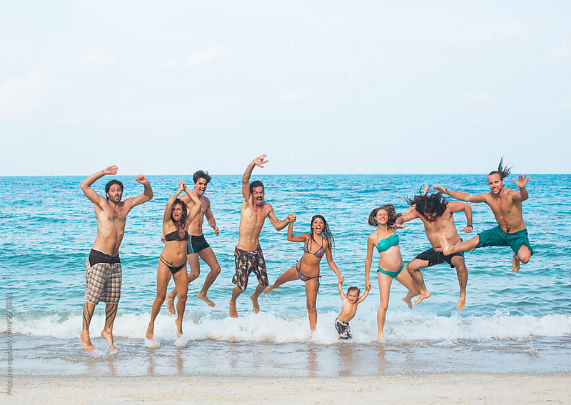 Friends Jumping in the Shallow by Mosuno for Stocksy United