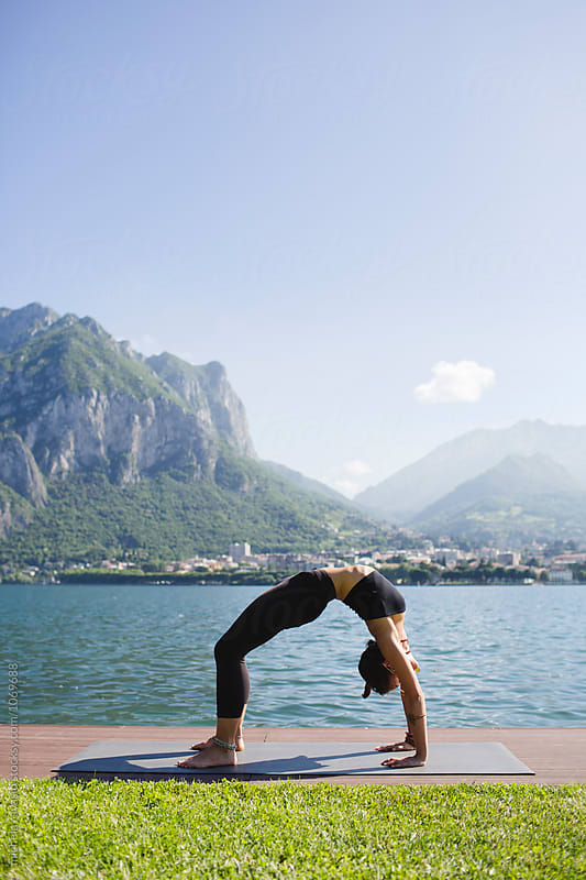 Woman doing yoga Backbending Pose by michela ravasio for Stocksy United