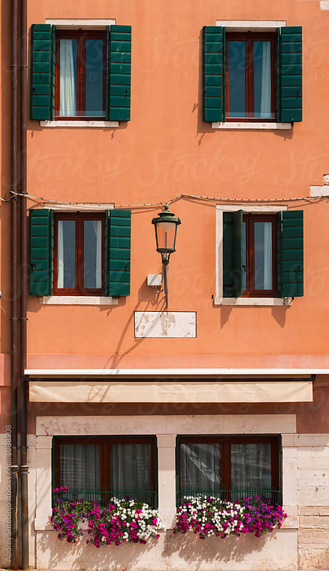 Building facade with small cafe and mediterranean stylish facade on upper floors.Italy by Marko Milanovic for Stocksy United