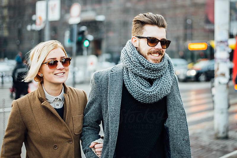Stylish Young Couple Taking a Walk by Nemanja Glumac for Stocksy United
