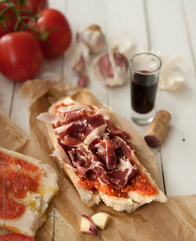 Spanish ham with tomato and bread (pan tumaca).  by Marta Muñoz-Calero Calderon for Stocksy United