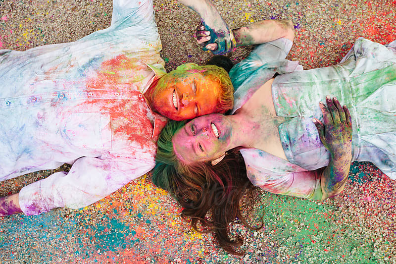 happy couple  in mess of color by Brian Powell for Stocksy United