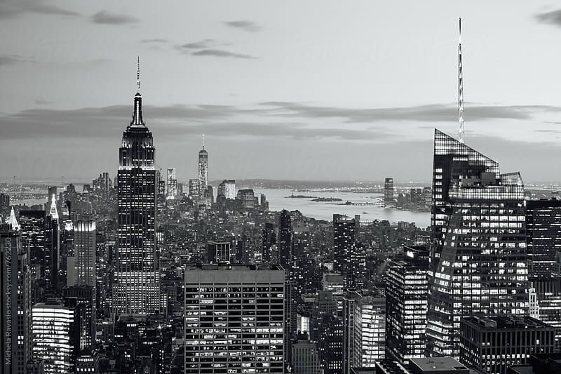 Cityscape of Manhattan at night in black and white by michela ravasio for Stocksy United