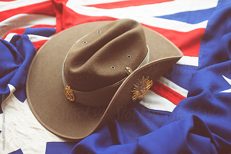 Close up of Australian army slouch hat on the Australian flag by Natalie JEFFCOTT for Stocksy United