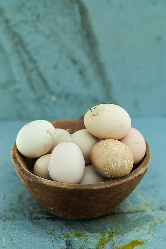 Fresh eggs in wooden bowl  by Studio Firma for Stocksy United