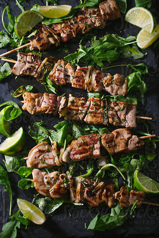 Skewer meat with arugula by Davide Illini for Stocksy United