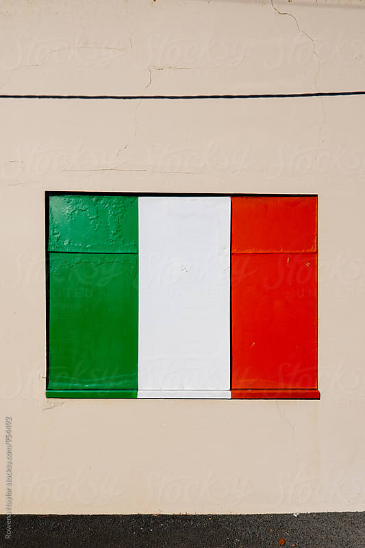 Italian flag painted on window shutters by Rowena Naylor for Stocksy United