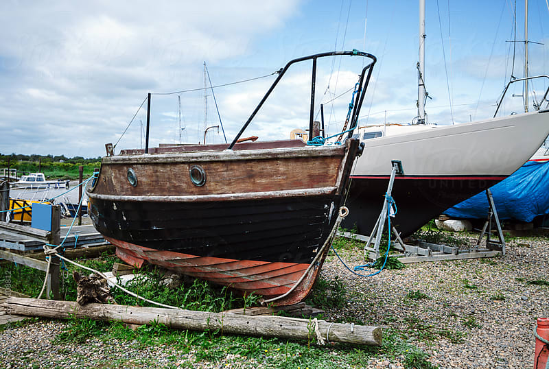 Sailing boat on a shipyard waiting restoration by kkgas for Stocksy United