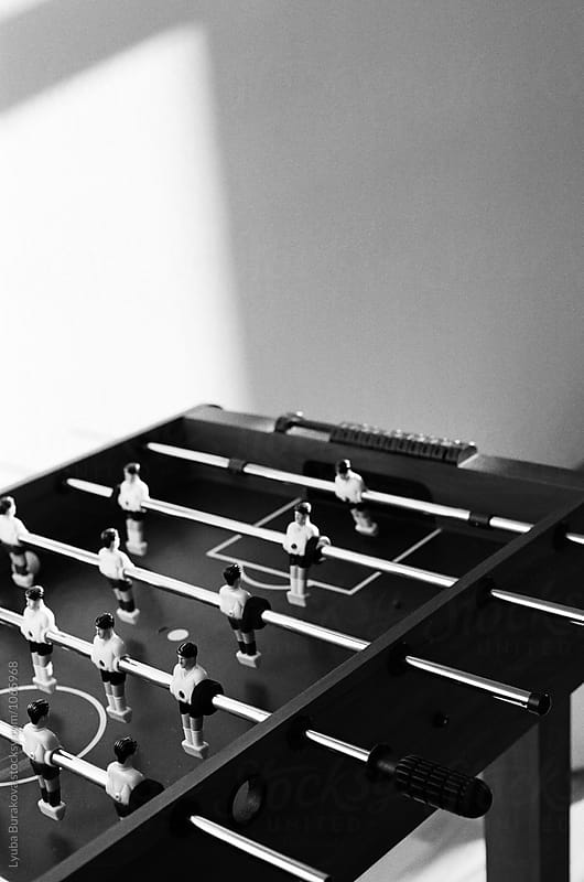 Table football in the evening sun by Liubov Burakova for Stocksy United