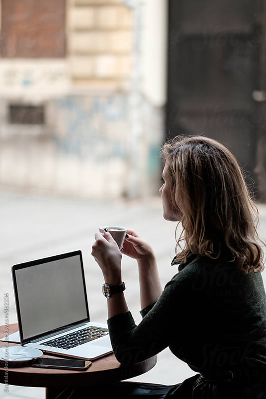 Young Woman Sitting at the Cafe with Laptop by Branislav Jovanović for Stocksy United