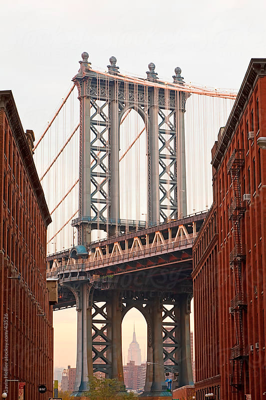 USA, New York City, Manhattan,  Manhattan Bridge spanning the East river between Brooklyn and Manhattan and framing the Empire State building by Gavin Hellier for Stocksy United