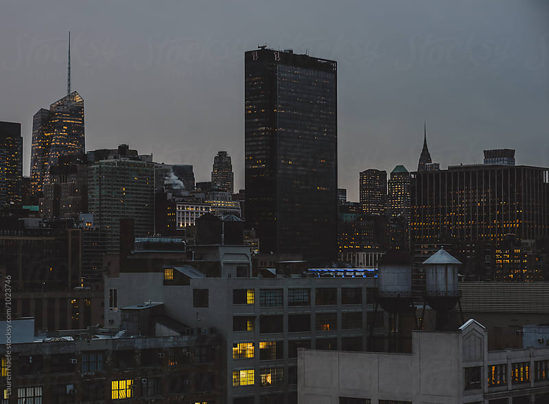 City skyline at dawn by Lauren Naefe for Stocksy United