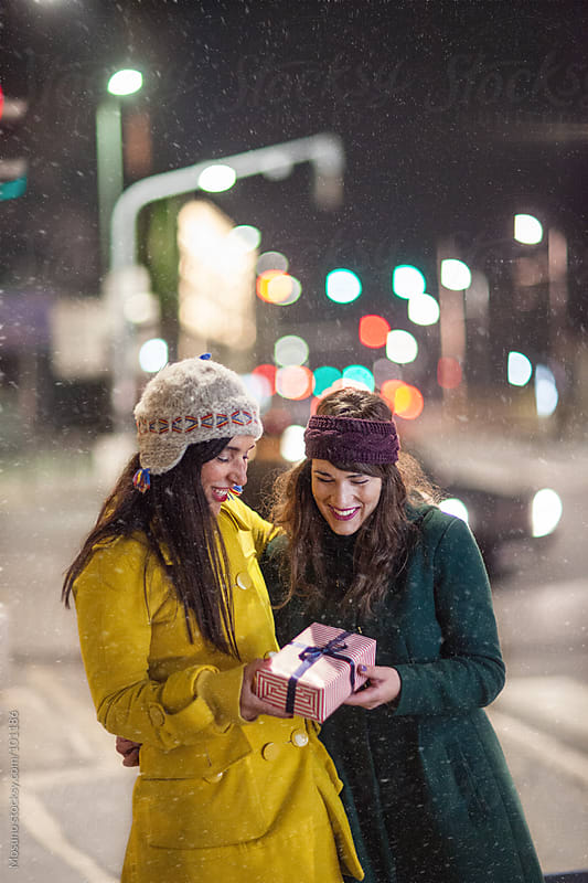 Friends Having Fun on a Cold Snowy Night by Mosuno for Stocksy United
