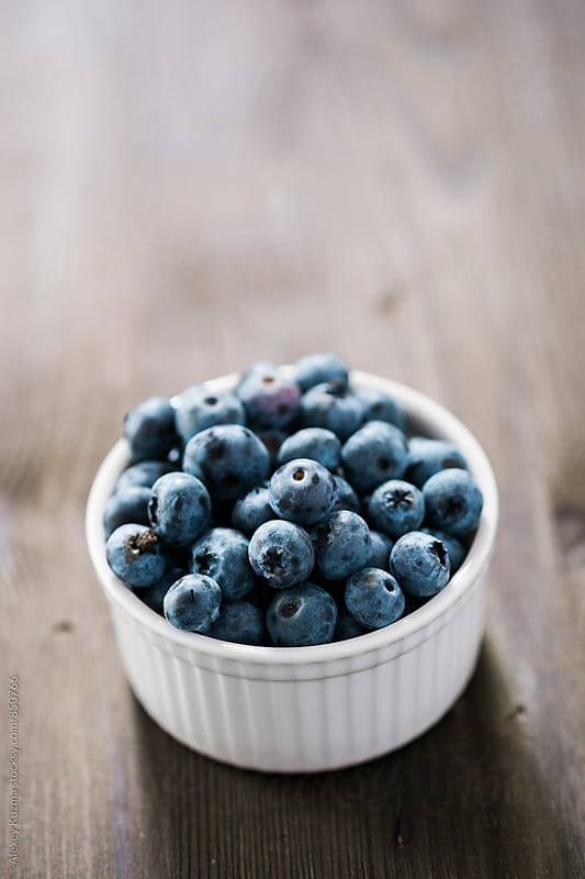 blueberries in a white bowl  by Alexey Kuzma for Stocksy United