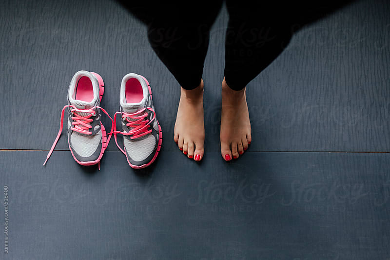 Barefoot Woman With Running Shoes by Lumina for Stocksy United