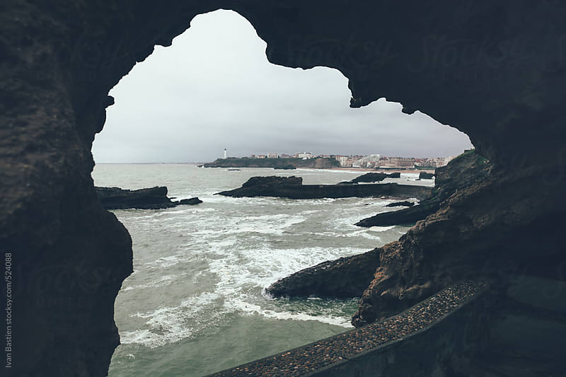 Biarritz lighthouse in Pays Basque, France, seen from a cave by Ivan Bastien for Stocksy United