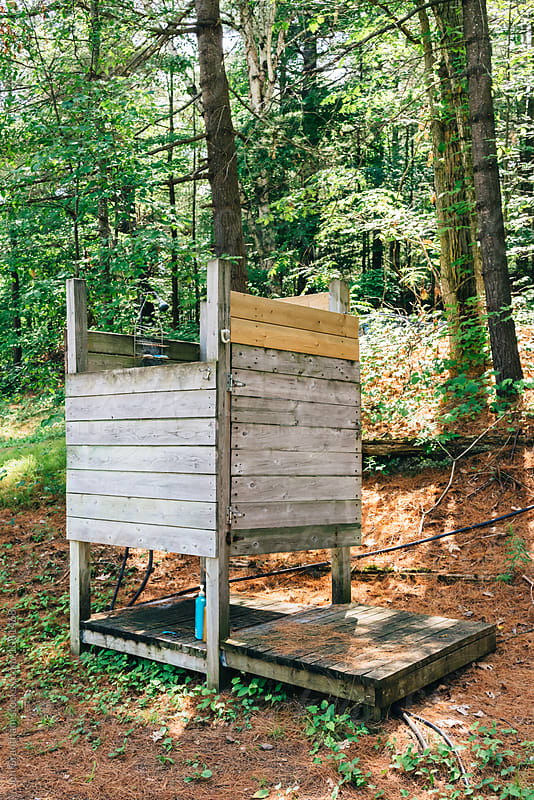 Rustic outdoor shower in the woods by Jen Grantham for Stocksy United