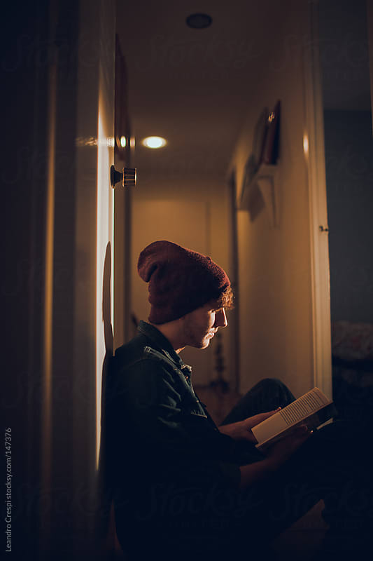 Man reading a book by Leandro Crespi for Stocksy United