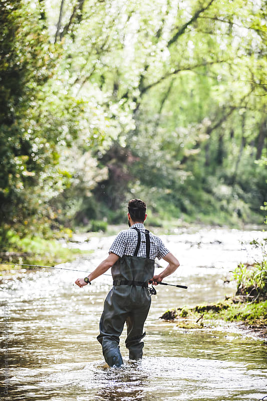 Young Fisherman Exploring the Wilderness in a Tuscan Small River by Giorgio Magini for Stocksy United